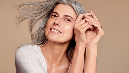 Why does mature skin lose luminosity?